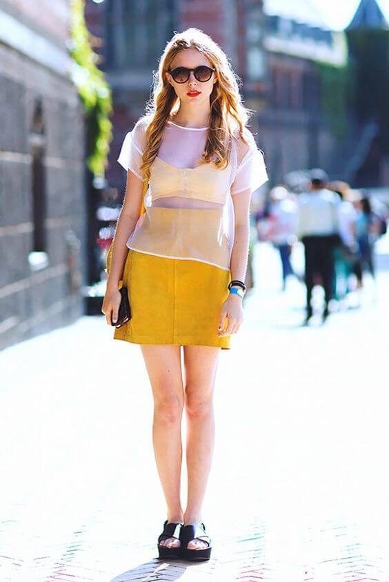 Suede yellow skirt matches with a bralette in the same color. The white transparent shirt seems like a perfect solution not to look provocative. #sheertop #summeroutfit