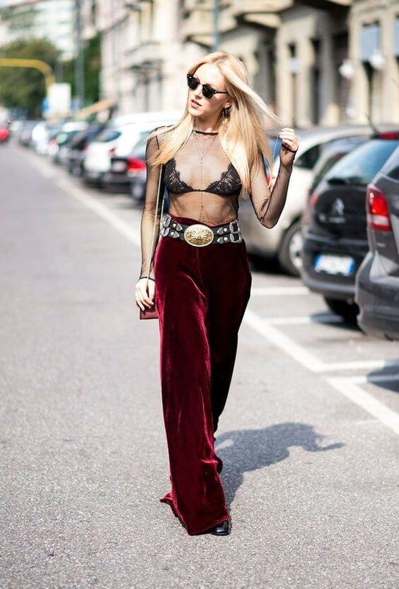 Red velvet pants might sound like a surprise for summer, but you can save them for special occasions. Add a vintage vibe with a big gold belt and transparent top. #sheertop #summeroutfit
