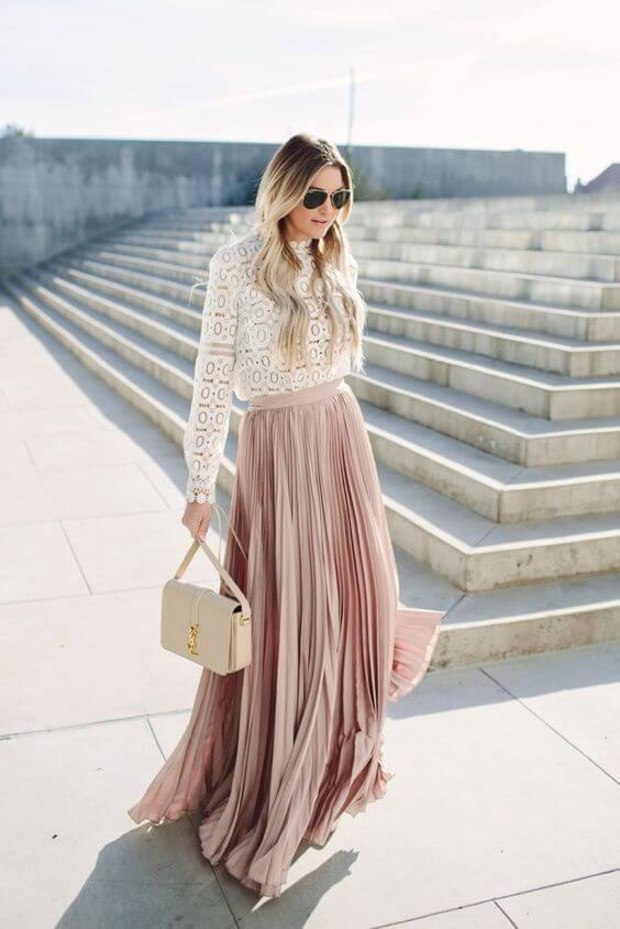 Blush colors are the best ones to style in the summertime. This lovely maxi pleated skirt in blush pink should be your choice for everyday wear. #sheertop #summeroutfit