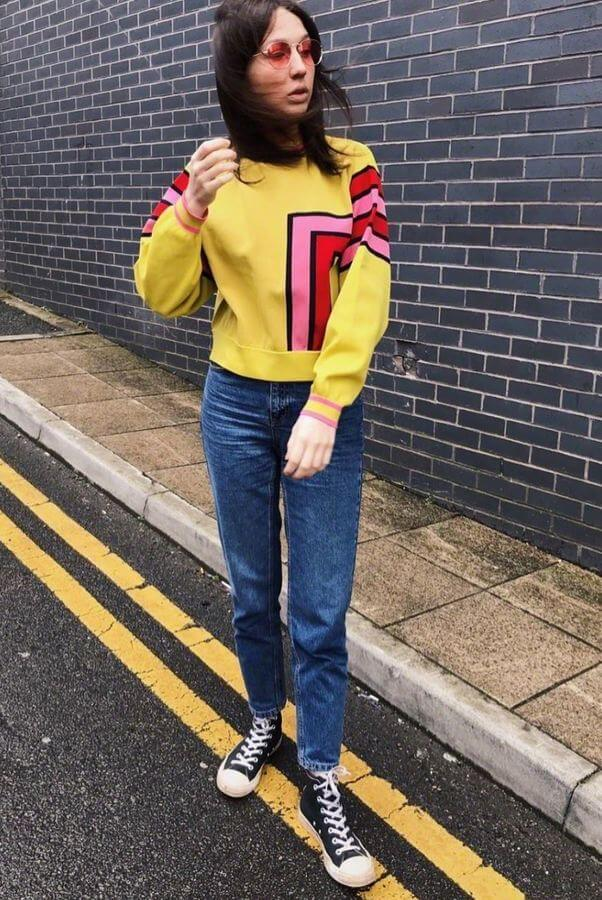 Say yes to a bright jumper with jeans look complete with your trusty converse sneakers. #converse #sneakers