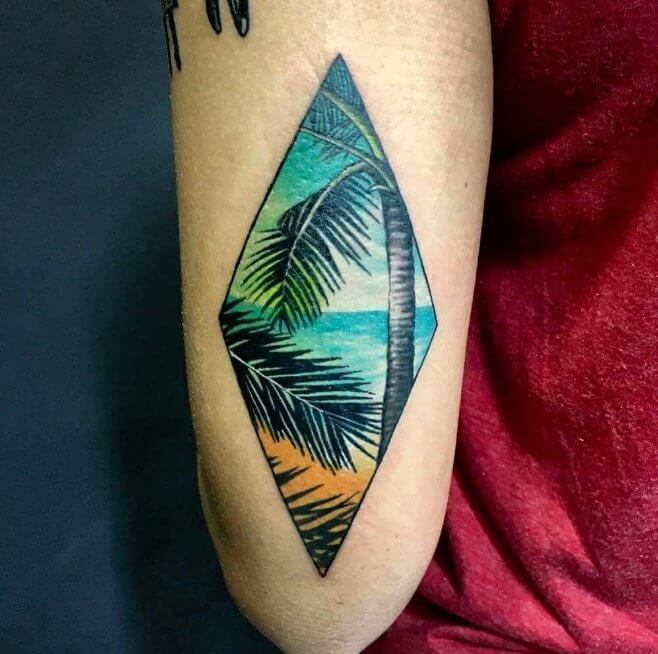 This diamond shaped tattoo will always remind you of seaside and beautiful palm trees #summertattoo #colorfultattoo
