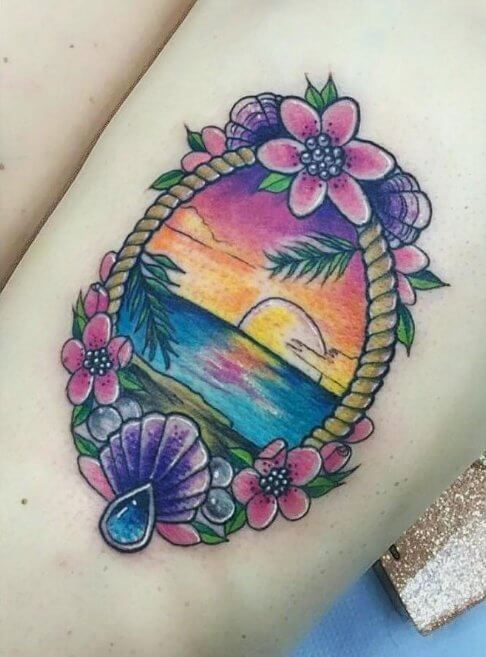Give your summer tattoo a girly touch by adding flowers, lace details, colors or a delicate frame around the lovely seaside scenery. #summertattoo #colorfultattoo