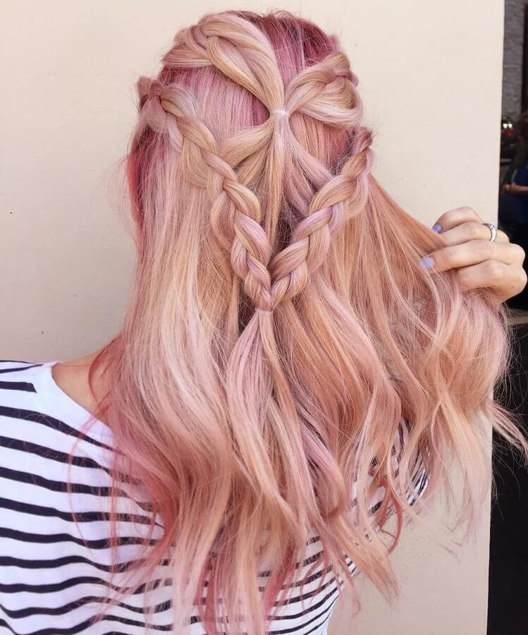 Pinky shades on your hair can make you look like a Barbie. If you want to achieve this look with an exciting twist, make two twisted braids and let your hair wavy and messy. #wavyhair #hairstyle