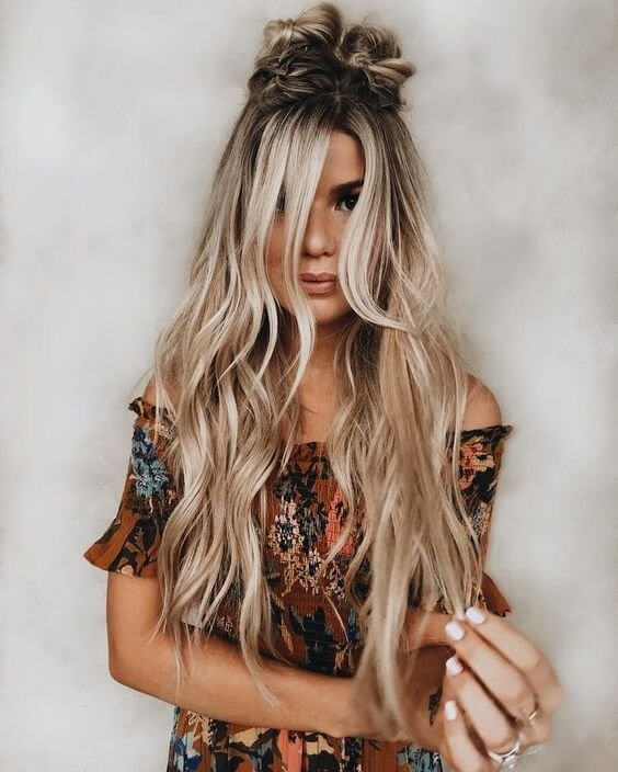 If you are bored of seeing a regular bun, then make it of your braid! This is great style inspiration for everyday wear. #wavyhair #hairstyle