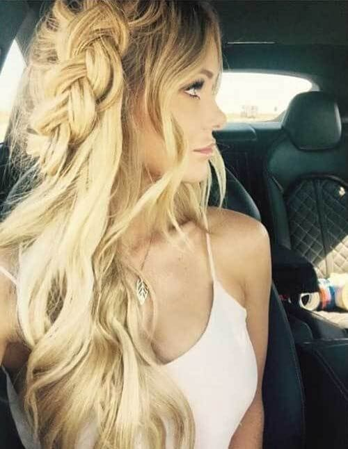 The long braided hairstyle is perfect for open music festivals. If you are into bohemian style and way of living, then summertime can be ideal time for trying this long side braided hairstyle. #wavyhair #hairstyle