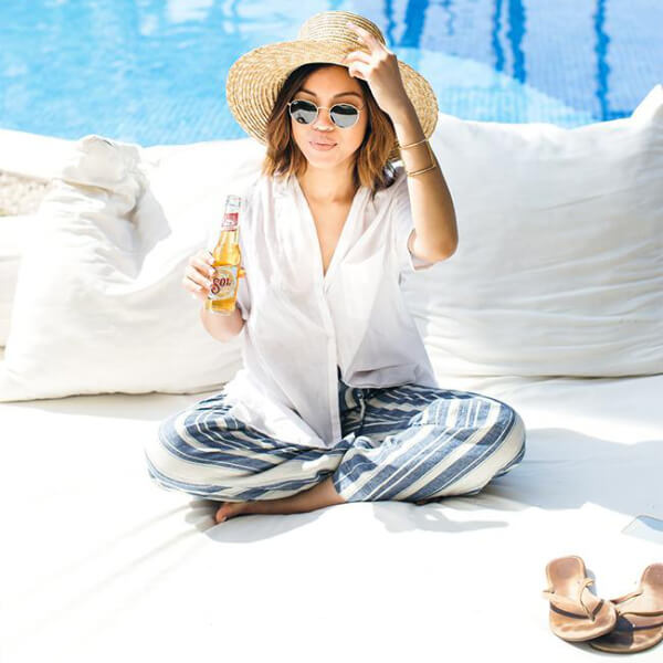 Striped blue linen pants and white button-down shirt are our favorites when it comes to pool outfits #4thofjuly #outfits