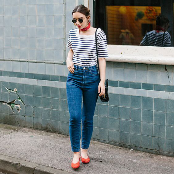 Fourth of July outfits can include your favorite pair of blue jeans, striped Breton shirt, and red flats! #4thofjuly #outfits