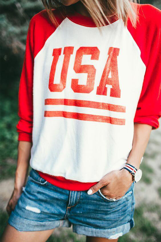 If you decide to go sporty and carry a message, let it be something like this. This lovely red and white sweatshirt works perfectly with denim shorts and sneakers. #4thofjuly #outfits