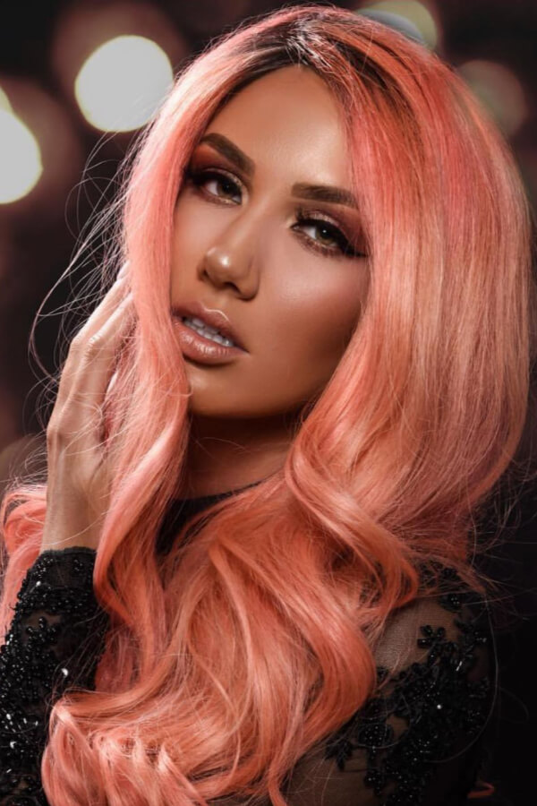Want to make a statement with your hair? Try this pastel orange shade!
