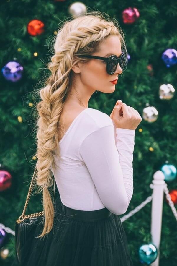Long fishtail braid is a great choice for woman with long voluminous hair