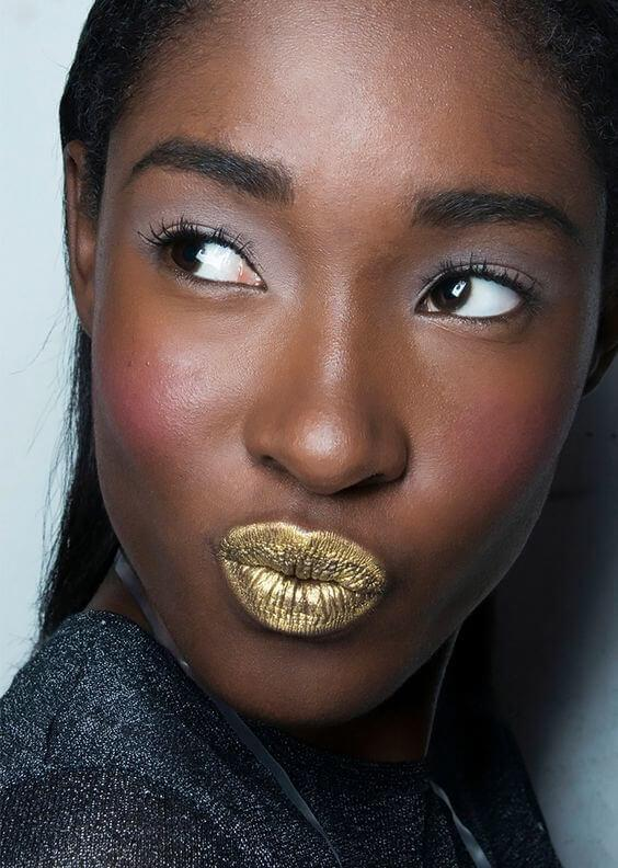 Fun and unique makeup with gold on lips