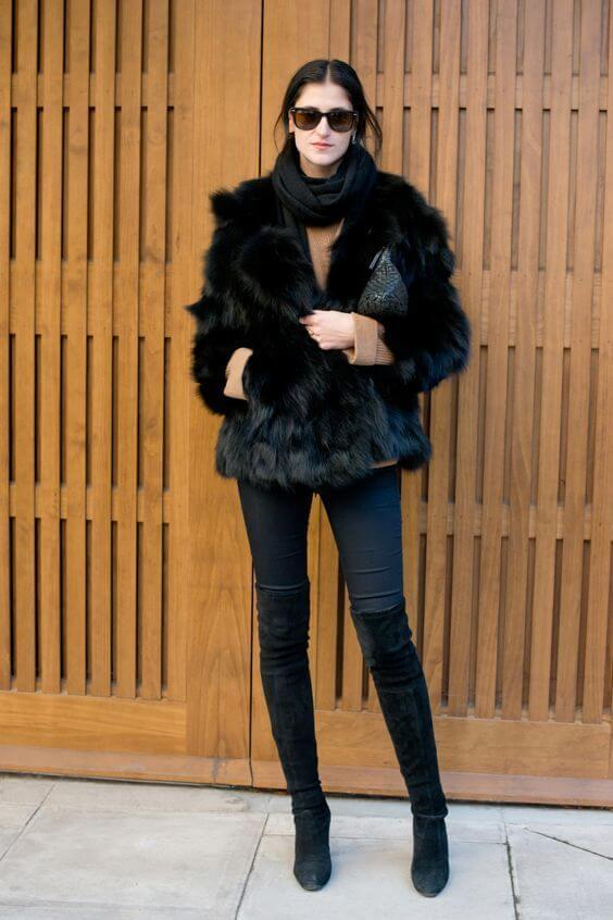 Faux fur coat will always keep you cozy, no matter what temperature is. Style it with jeans and thigh-high boots for your working hours.