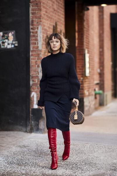 Midi skirts hems and thigh-high boots overlap, making one stylish and very polished combination. This is one of the solutions on how to style your tall boots for work.