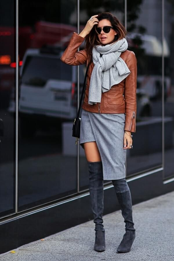 Outfit with asymmetric skirt, leather jacket, and grey suede boots