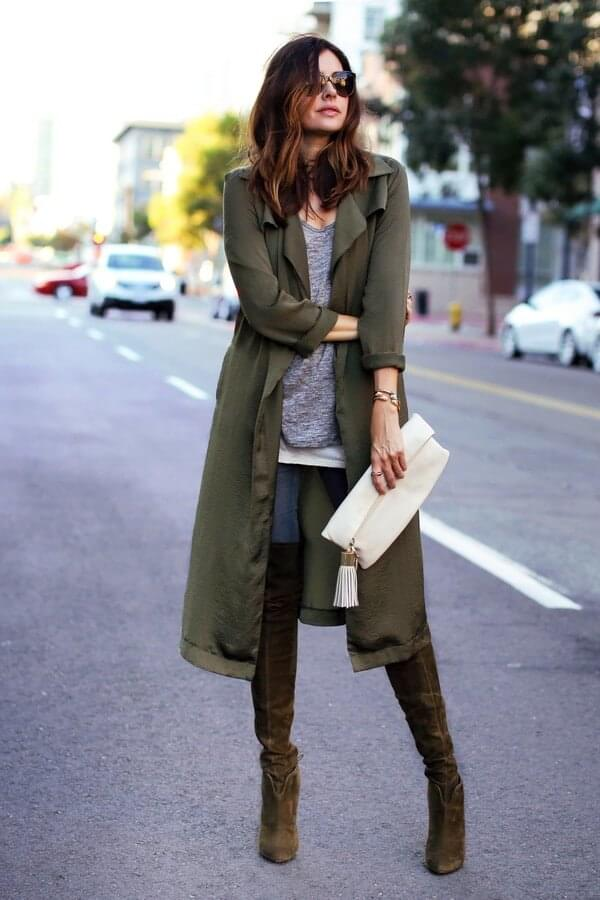 Green parka, a grey blouse, jeans, and super cool tall boots