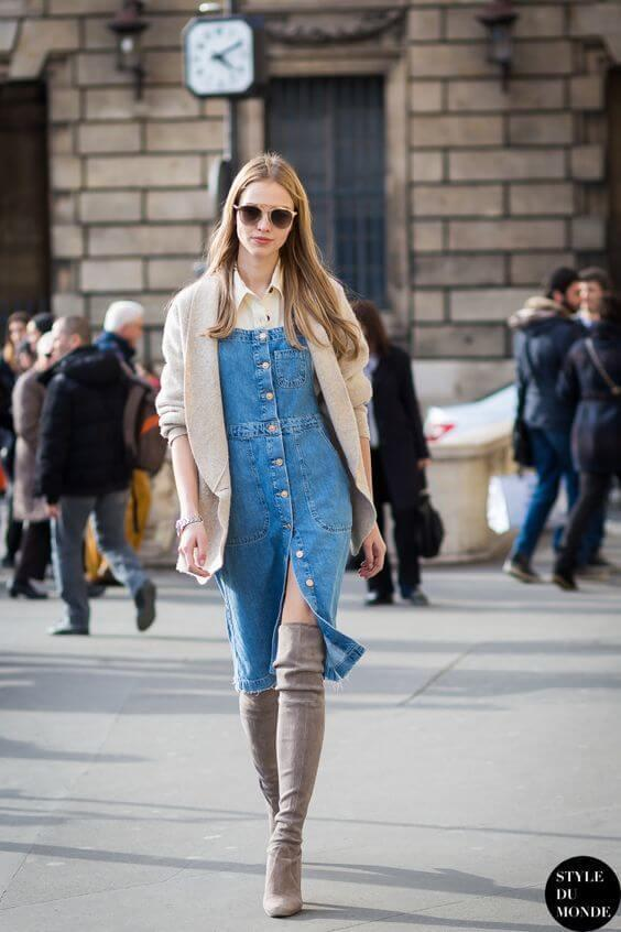 Denim button-down dress seems like a retro piece with a modern twist - thigh-high boots. They match the color of cardigan and polo blouse below the dress.