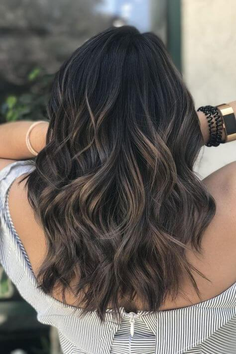 Cold highlight tones such as blonde or light brown with grey pigment will make your hair look perfect for all occasions. #haircolor #warmblackhair