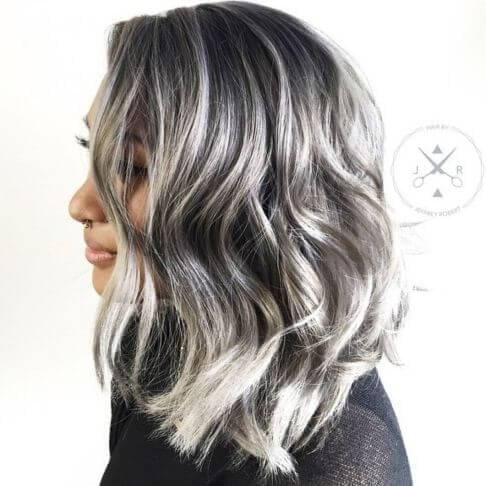 Make a perfect contrast on your hair by highlighting your black hair with white and grey shades. #haircolor #warmblackhair