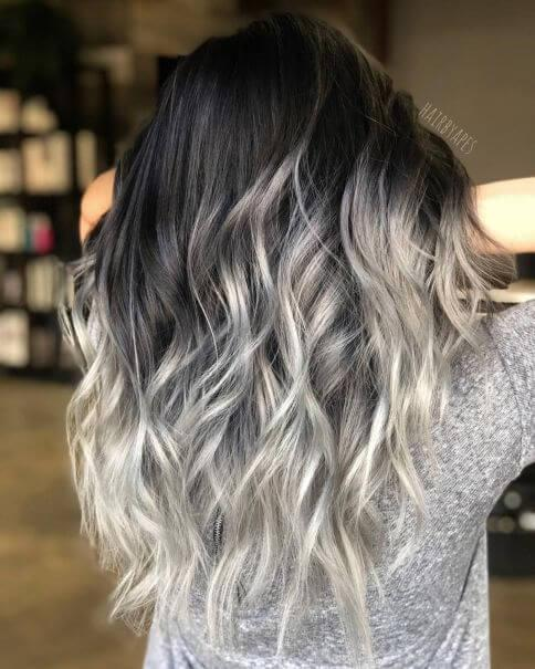 Silver ends will make your hair eye-catching and gorgeous. Try curling your hair for the best results possible. #haircolor #warmblackhair