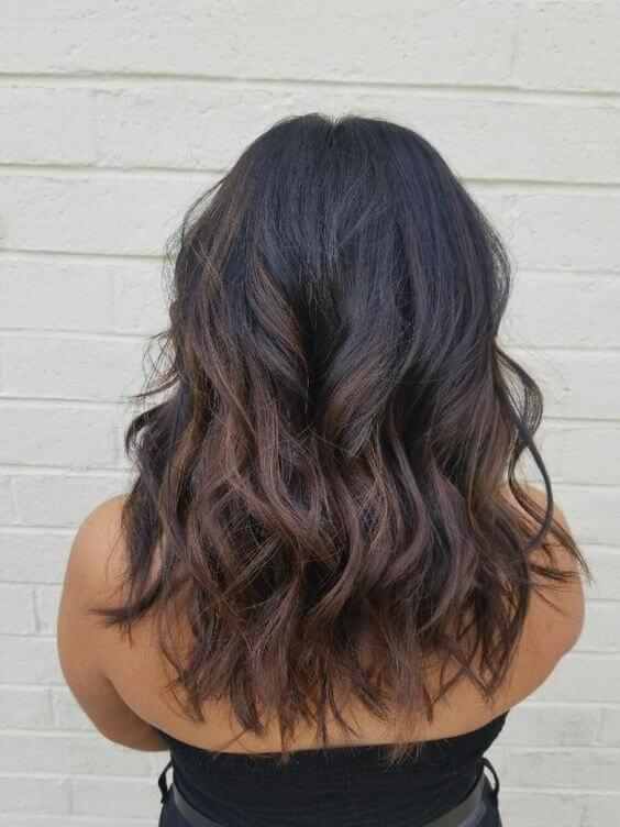 Balayage is a known technique that many girls adore. You can see how it looks when you get caramel shade and black hair combined. #haircolor #warmblackhair
