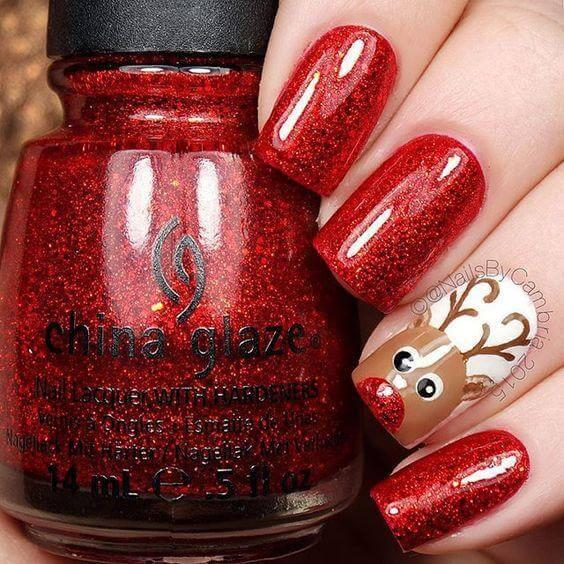 Let your deer be seen on your ring finger by leaving that finger white, instead of red. #winternails #naildesign