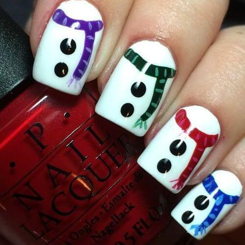 Reviving snowman on your nails is a cute and unique idea. You can absolutely go with this kind of design for the winter holidays. #winternails #naildesign