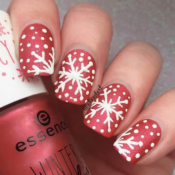If you want winter to come earlier, invite it with snowflakes on your nails. Red is an excellent choice to match with white. #winternails #naildesign