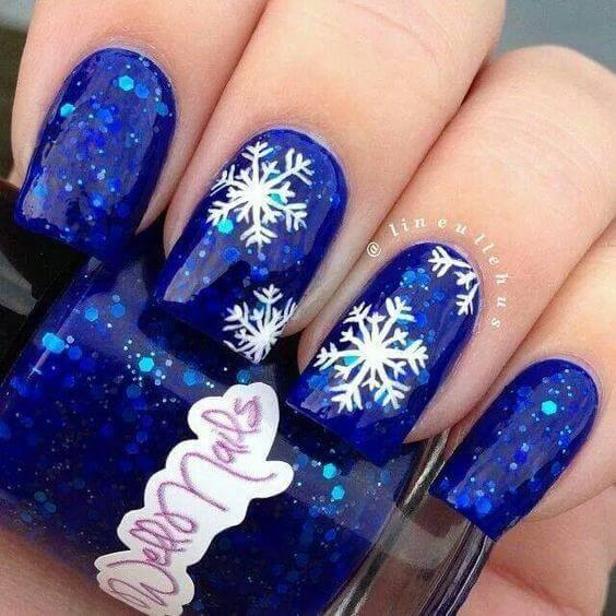 Different colors on your nails can make you stand out from the crowd. Dark blue with sequins is one of those shades. #winternails #naildesign