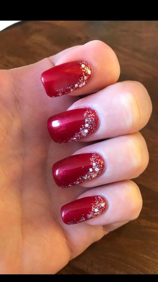Even without design in Christmas spirit, this manicure in red and with sparkly details can make you shine wherever you go. #winternails #naildesign