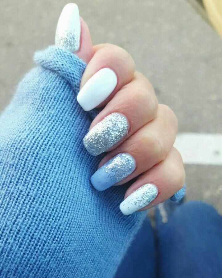 Match with the snowy weather outside with light blue nails with a lot of sparkly details on them. #winternails #naildesign