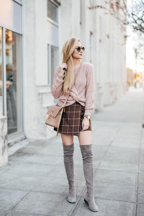 Neutral blush shades are not typical for winter, but they look very nice when combined with other colors. Grey thigh-high boots act like socks and like boots at the same time. A mini skirt that is wrap designed looks very nice in combination with over-the-knee boots. #skirtsinwinter #skirtoutif #winteroutfits