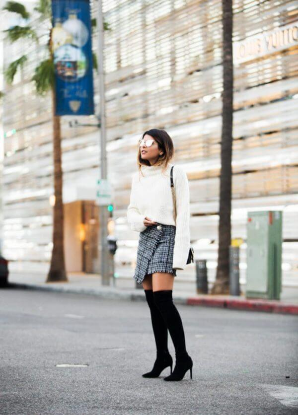 Tweed wrap skirt looks fabulous combined with black suede over-the-knee boots and a chunky white sweater. #skirtsinwinter #skirtoutif #winteroutfits