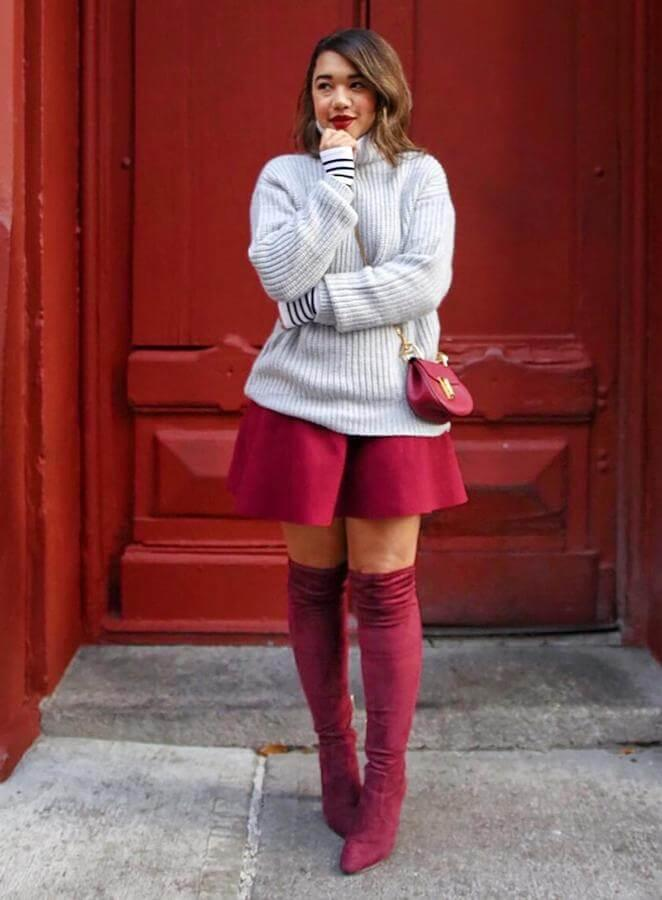 Cozy sweater and mini skirt might seem like an extreme combination for a winter night out. However, if you opt for thigh-high boots, you don't need to worry about cold anymore. #bootsoutfit #nighout #nightoutlook