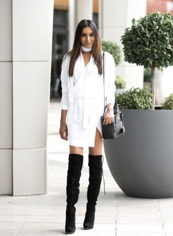 Monochrome style took hearts of many It girls. It is simple, yet interesting. Black thigh-high boots combined with the white dress look sophisticated and very comfortable for a night out. We can already see you sitting by the bar with a cocktail in your hand. #bootsoutfit #nighout #nightoutlook