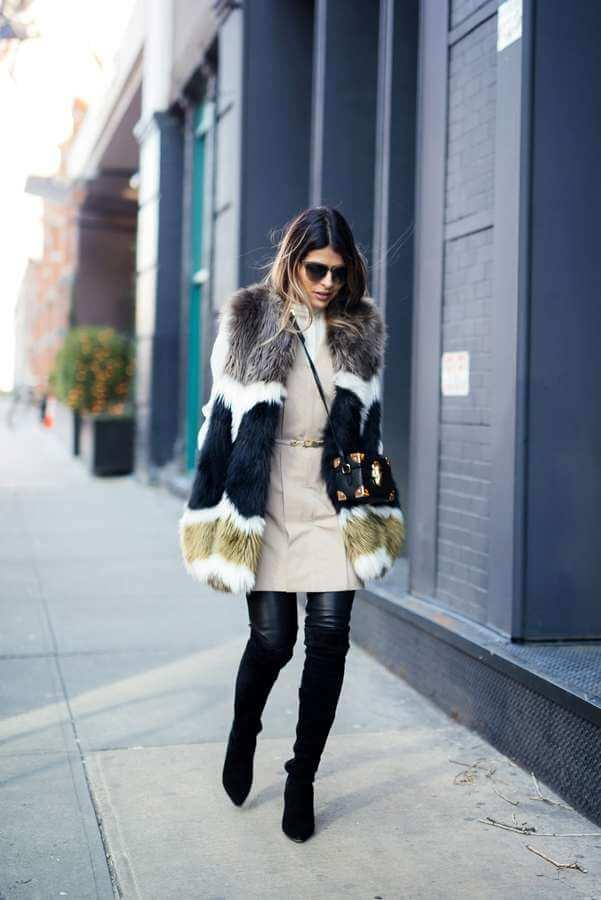 Looking cool in winter? No problem. Match a colorful faux fur vest with a beige dress, leather leggings, and tall boots. Leggings will keep you extra warm and cozy. #bootsoutfit #nighout #nightoutlook