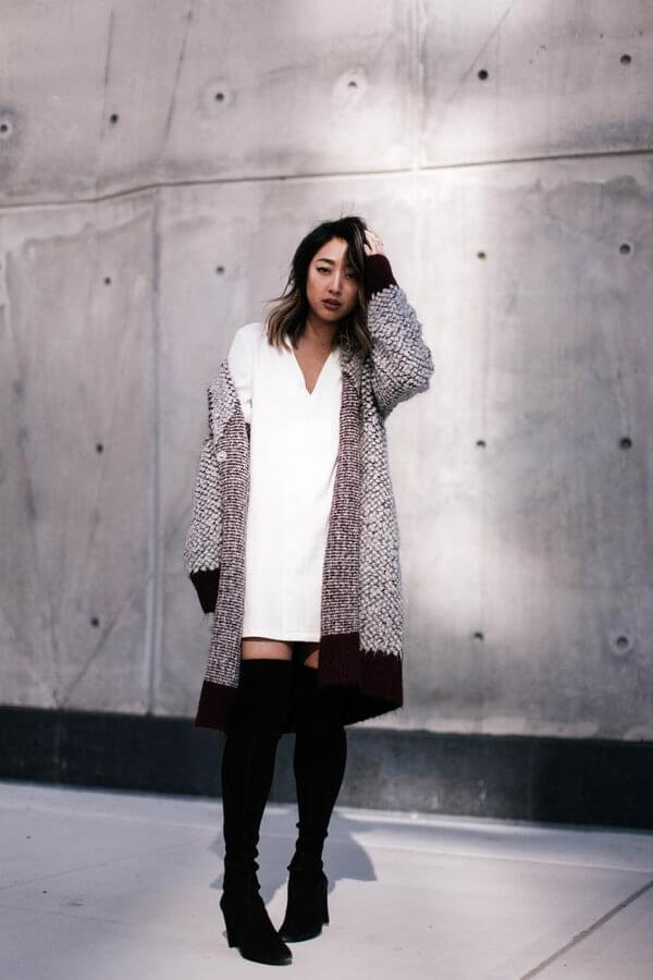 You will surely be noticed in this snow-white dress. Straight cuts are soothed with a chunky sweater and over-the-knee boots. #bootsoutfit #nighout #nightoutlook