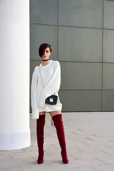 Snow white sweater dress is mixed with burgundy boots for a chic and casual night out with your friends. Add a crossbody bag and a choker - trendy accessories that will add a cool vibe to this combination. #bootsoutfit #nighout #nightoutlook