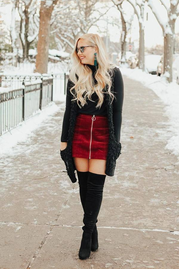 Corduroy is an ideal material to wear in the winter time. It will keep you cozy while providing you a retro, stylish look. This girl opted for mini corduroy skirt, black turtleneck, and faux fur vest. #bootsoutfit #nighout #nightoutlook