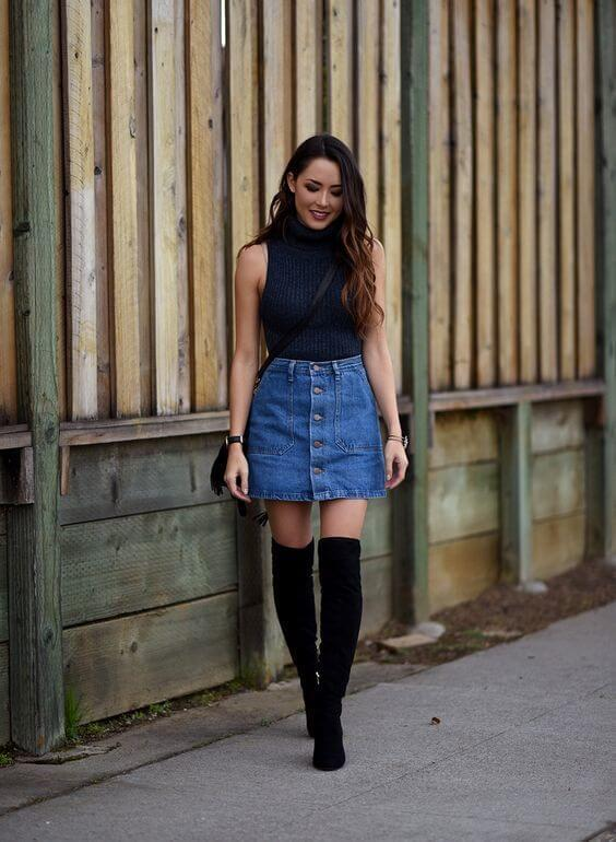 The denim skirt is one of those items that never go out of style. That is why you can wear it from early morning to the late night in the club. #cluboutfit #highboots