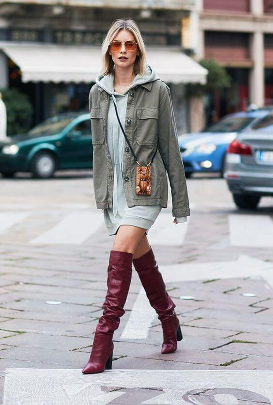 To show you how slouchy boots are versatile, we have found this look. It is ideal for the club - green parka, grey sweater dress, and tall boots will make you stand out from the crowd. #cluboutfit #highboots