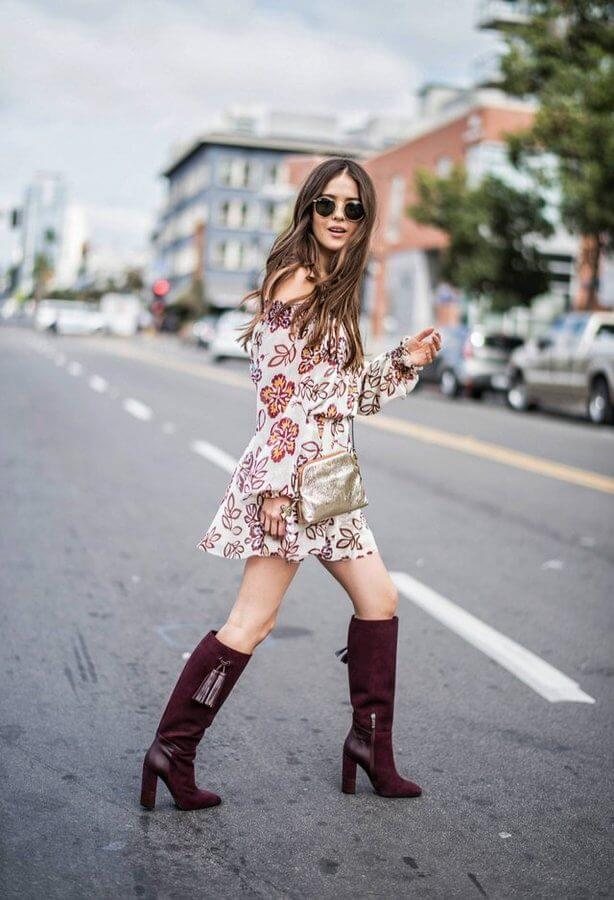 The off-the-shoulder dress looks very flowy and summerish. However, while it is still early fall, you can mix this dress with burgundy knee-high boots. These boots have block heels which automatically make them the most comfortable in the world. You can add a shiny accessory, such as a crossbody bag. #highboots