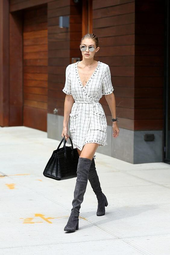 This supermodel pairs wrap dress with thigh-high boots. The outfit seems effortless, casual, and pretty comfortable. #highboots