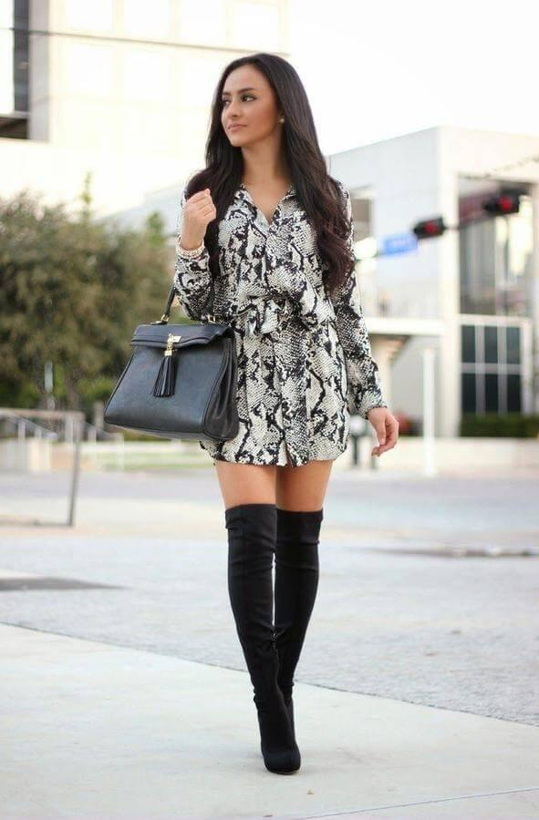 If you were following trends, then you have probably have seen that one of the main prints this season is snakeskin, i.e., animal print. Believe it or not, printed snakeskin dresses are easy to style with black over-the-knee boots. #highboots