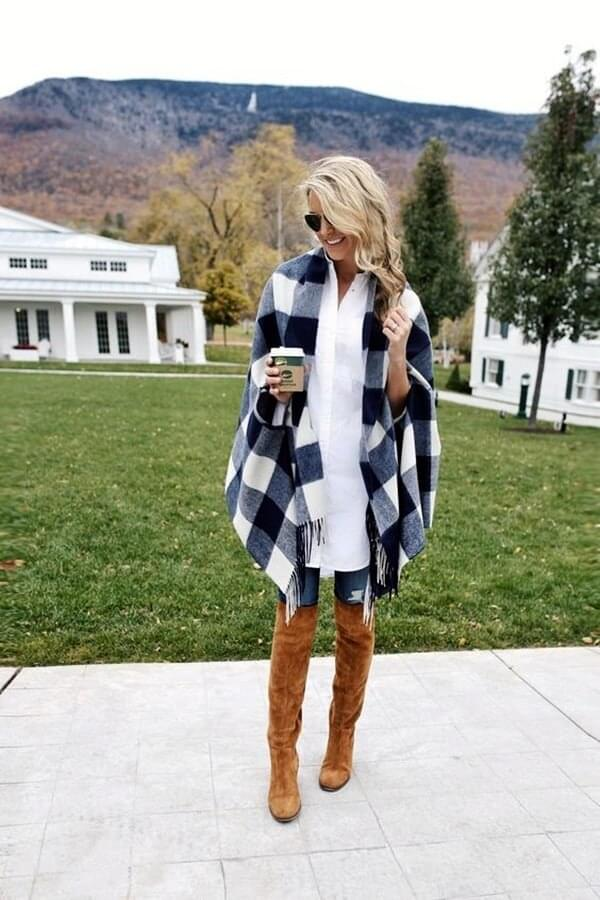 Make sure to have at least one poncho in your closet. It will keep you warm and very fashionable at the same time - wear it with jeans and brown thigh-high boots. #highboots