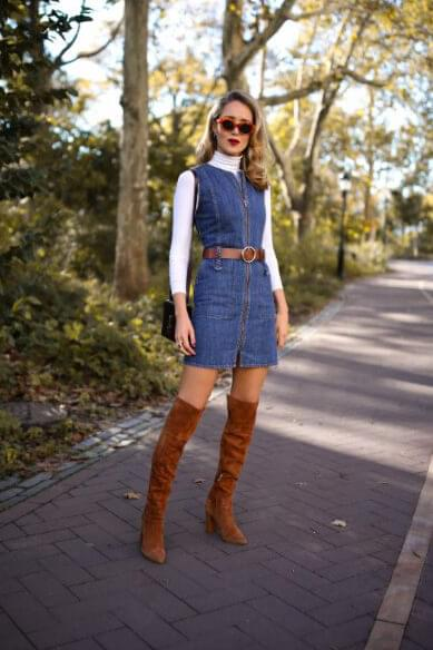 Add cowboy vibes to your daily outfits, by wearing denim dress with brown suede details. #highboots