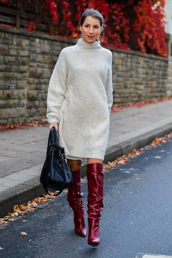 Red slouchy boots a la Isabel Marant perfectly work with an oversized sweater dress. If you are looking for something to wear on a daily basis, then this should be your first choice. #highboots