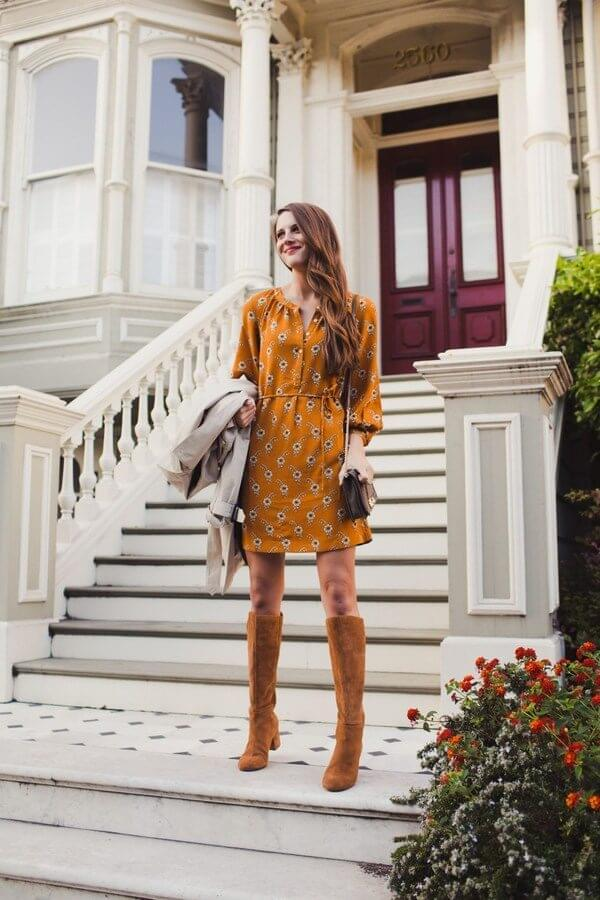 Warm orange shade is one of the best fall shades. The dress is accessorized with flowers and styled with over-the-knee boots. Perfect for sunny fall days, right? #highboots