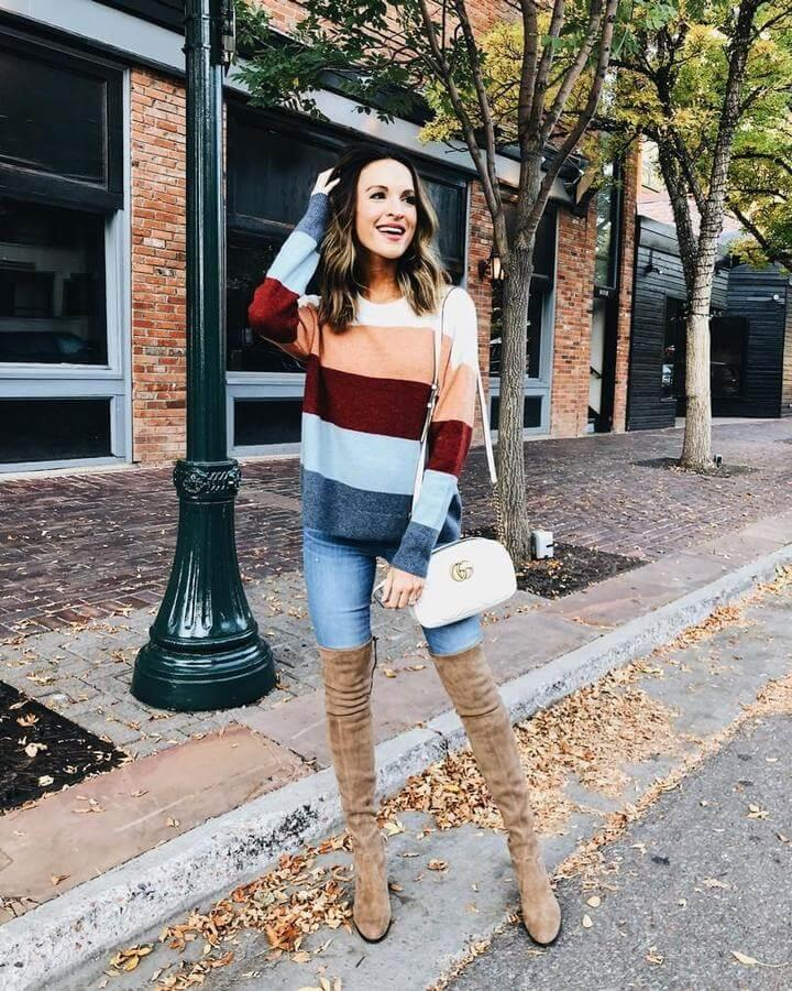 Never say no to striped sweaters or tops. They can be your favorite item no matter what season is. Combined with both jeans or skirts they can look pretty interesting and playful. The only thing you need to do is to find beige thigh-high boots that will keep you warm during cold months.