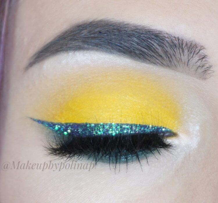 Green Glitter Eyeliner and Yellow Eyes