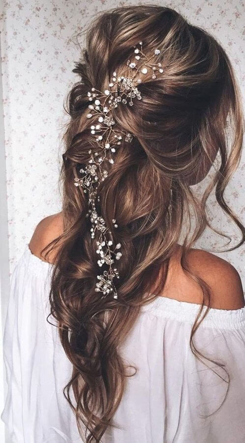 We have to admit – this is one of our favorites. It is a pure, elegant hairstyle that will draw all attention on you at your prom night. Maybe it is because of the hair accessory, and perhaps it is because of a loose braid.